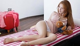 Playful redhead teen Michelle doing herself