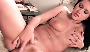 Vibrations lube her pussy for finger fucking