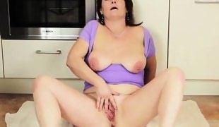 brunette mature lady playing with her large vagina.