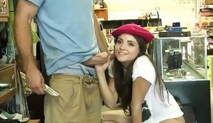brunette cutie puts on the red cap and enjoys a cock